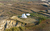 Isolated farmstead and Chapel seen from Archangelos Hill, Santorini, Greece - distant view